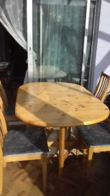 Pine drop leaf table and 4 chairs
