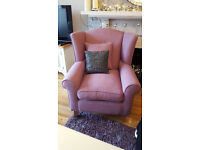 Mauve/ pink winged armchair