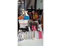 Amazing Wii Bundle! 2 guitars, wii fit board, 4 controllers, 18 games, mic, steering wheel!
