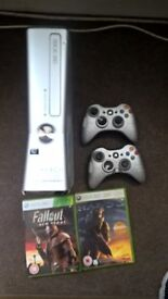 xbox 360 s x2 controllers and 2 games