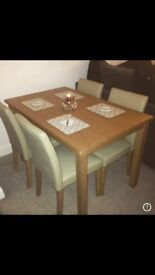 Oak Table with 4 beige faux leather chairs