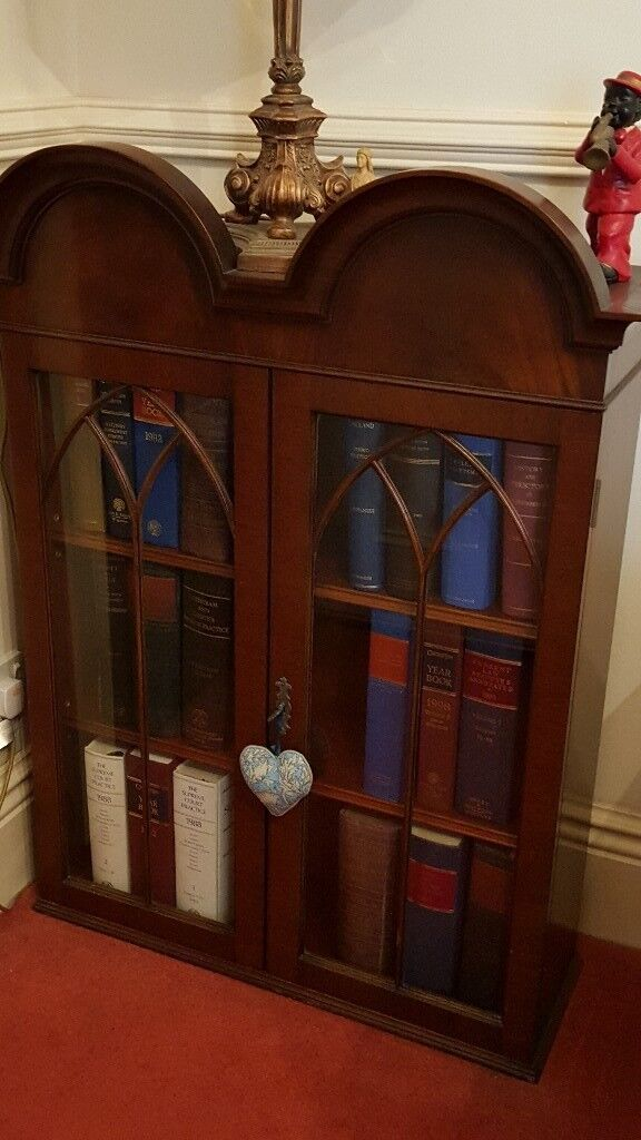 antique bookcase, glazed with key and arched top