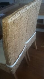 Rattan tall back dining chairs 1 pair like new.