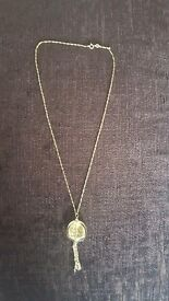 9ct yellow gold necklace with glass and gold leaf pendant