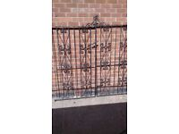 Decorative black iron gates