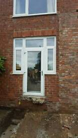 UPVC white French door with side windows back double glazed