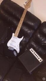 electric guitar with the amp