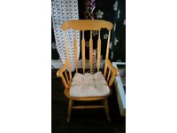 Rocking chair with cram cushion.