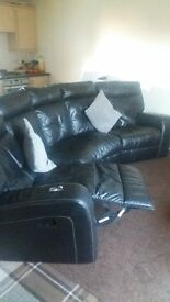 Black Leather Corner Settee. Recliners on both ends. Excellent condition.