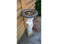 nearest offer secures stone - statue and bird table