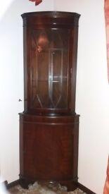 Mahogany corner cabinet.