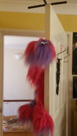 Pink and purple fluffy string puppet