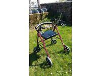 4 wheeled rollator (walking aid)