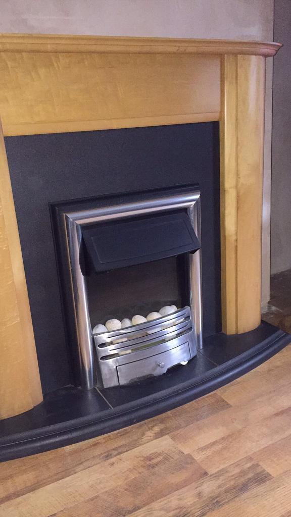Wooden fire place with black hearth and electric firein Barlborough, DerbyshireGumtree - Modern free standing fire place light wood built in electric fire black hearth very good condition