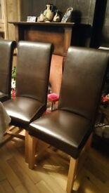 8 Black leather dining chairs
