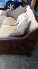 Ex display quality Leather brown sofa,