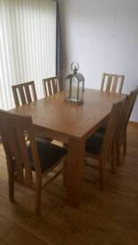 Oak extending table with 6 oak chairs