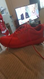 Red nike trainers size 8