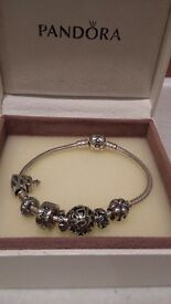 Genuine Pandora Bracelet with 7 charms included (charms can be bought seperatly)