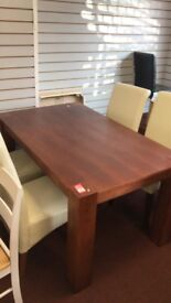 brown table and 4 cream leather chairs