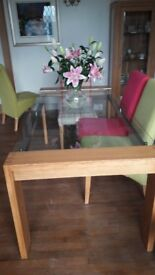 Glass topped dining table with oak frame and legs