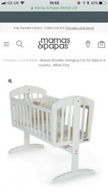 Mamas and papas swing in crib (cot)