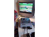 Genuine Retro SNES games console with Mario Kart, Mortal Combat 2 and Donkey Kong Country