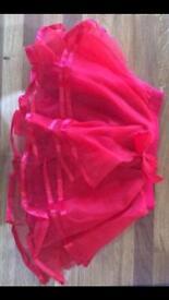 Brand new red tutu skirt. Age 5.