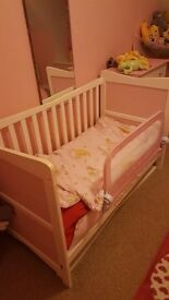 Pink and white cot bed