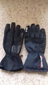 2 pairs of (small) motorcycle gloves.