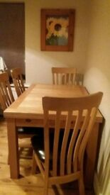 Oak extending dining room table and 6 chairs