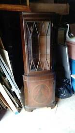 Bow fronted cupboard
