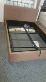 A brand new still boxed mocha double ottoman bed frame.