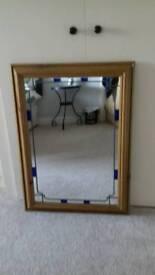 Wooden framed mirror - unusual detail.