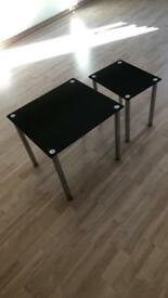 Black glass tables set