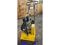 Petrol wacker plate compactor for trench slab path foundations