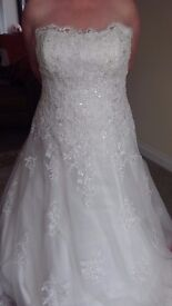 Wedding Dress Size 20 strapless white satin with soft net overlay with sequined applique