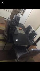 Beautiful brand new dining table with 6 leather chairs
