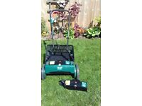 """""""Coopers"""" battery powered lawn mower"""