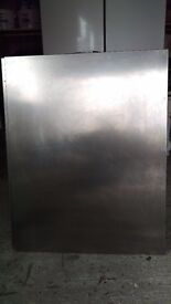 Stainless steel splash back and cooker hood