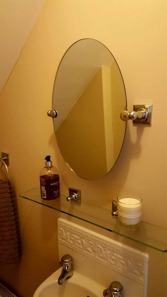 Oval mirror with glass shelf and chrome fittings