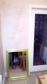 Bevelled edge mirror with bevelled edge golden frame