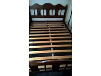 Dark brown double bed frame with memory foam mattress