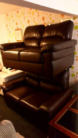 REDUCED...2 X 2 SEATER BROWN LEATHER SOFAS VERY COMFY £69.99 THE PAIR VIEWING WELCOME