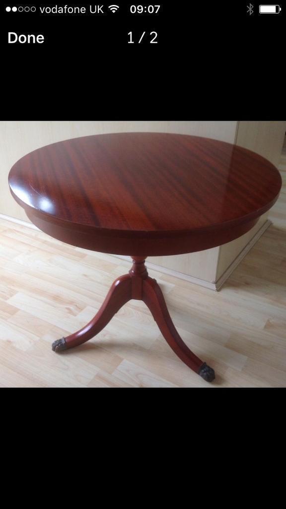 Round inlaid mahogany side table