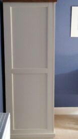 Three door bedroom wardrobe in off white and oak.