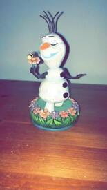 Disney traditions Olaf with flower