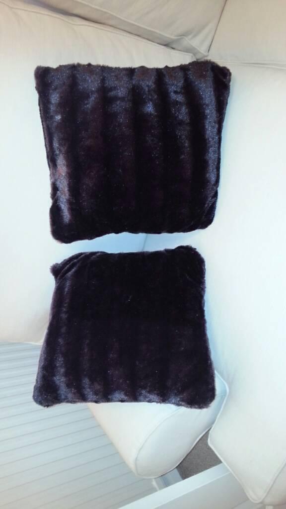 Pair of black cushions