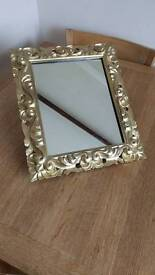 Beautiful mirror, old style, wooden surround which would paint
