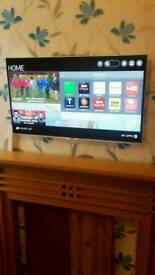 """LG 40"""" 4K Ultra HD Smart TV with built in Satellite & Cable tuners"""